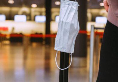 face mask on luggage